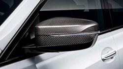 Зовнішнє дзеркало M Performance з вуглецевого волокна.